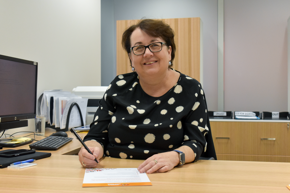 Development for Child Protection CE Cathy Taylor signs the Family Matters pledge