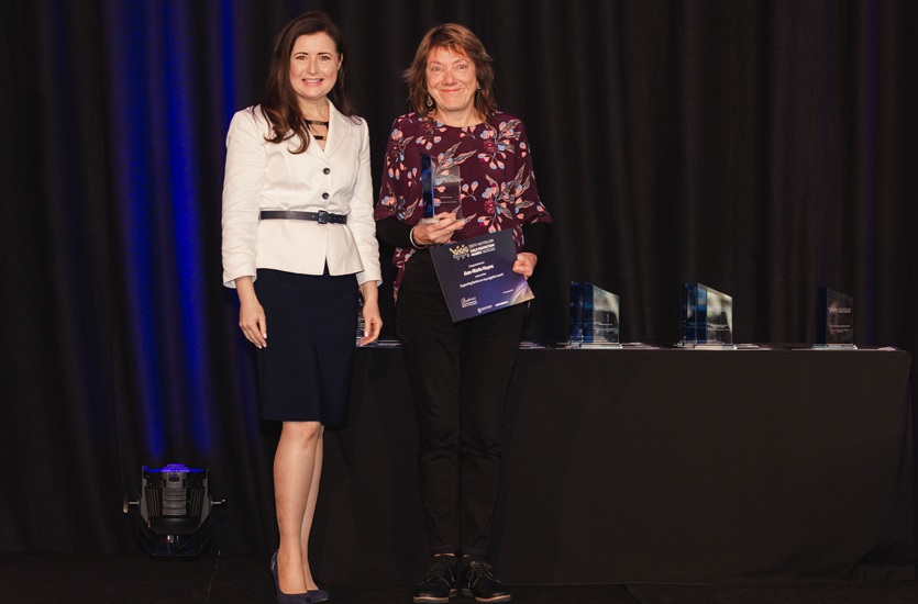 Ann-Marie Hayes accepts the award from Minister Rachel Sanderson