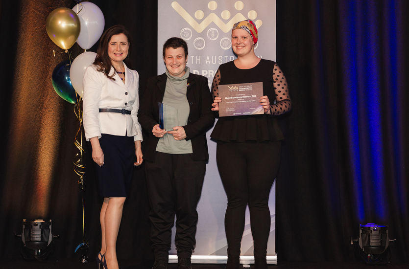 Minister Rachel Sanderson presents the award to DHS lived experience network